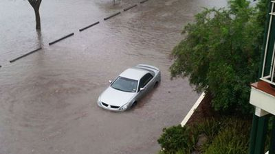 A car flooded in Fisher St, Brisbane (Supplied, Jessy Webber)