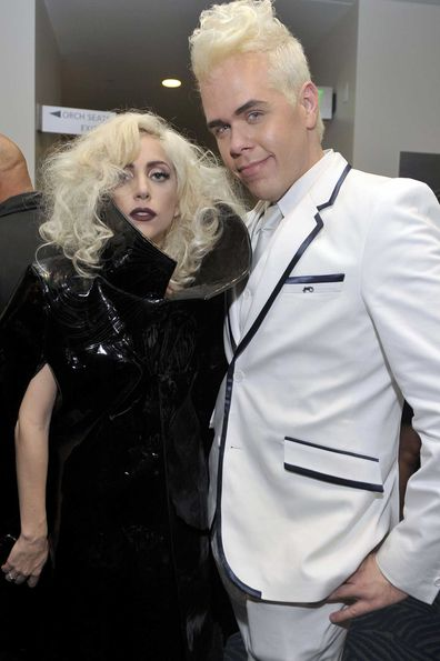 Lady Gaga and Perez Hilton pose backstage at the 2009 American Music Awards.