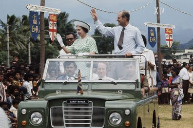 Prince Philip and Queen Elizabeth wave to the crowed during a royal tour of Fiji in 1977.