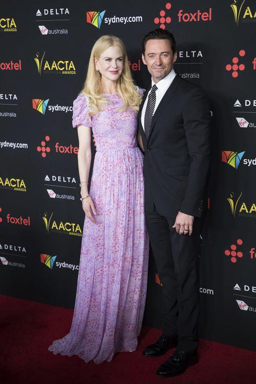 Nicole Kidman, left, and Hugh Jackman pose for photographers upon arrival at the AACTA International Awards. (AAP)
