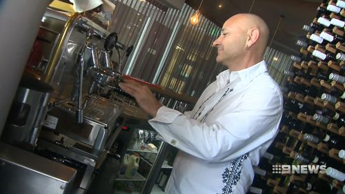 Main Beach restaurant owner Carlo Percuoco said he would join a class action to recoup their losses. (9NEWS)