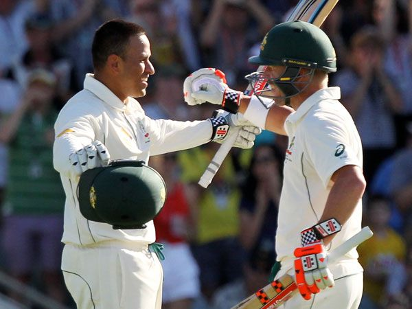 Usman Khawaja and David Warner celebrate their massive partnership. (AAP)