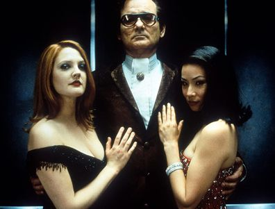 Drew Barrymore, Bill Murray and Lucy Liu on the set of Charlie's Angels.