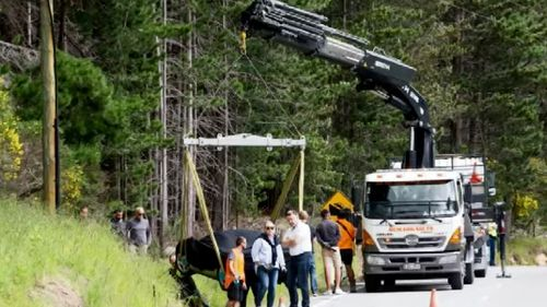 The McLaren F1 racer had to be lifted out of the ditch. (9NEWS)