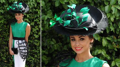 Fashions on the Field finalist Shauna Dennett poses for a photo on Oaks Day at Flemington Racecourse (AAP).