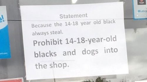 Melbourne milk bar places racist sign on window banning black teenagers