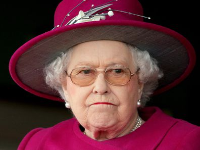 Queen Elizabeth II frowning, looking grumpy at Newbury Racecourse on April 17, 2015.
