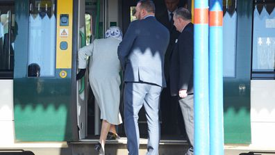 Queen Elizabeth II walks alongside station manager Graeme Pratt as she arrives at King's Lynn railway station in Norfolk, ahead of boarding a train as she returns to London after spending the Christmas period at Sandringham House in north Norfolk.
