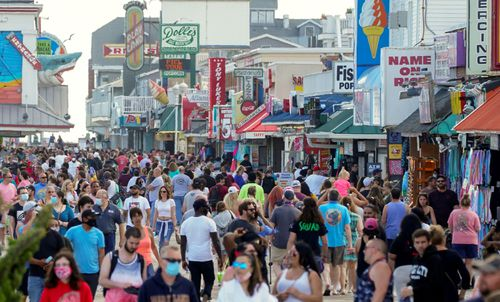 With the relaxing of coronavirus restrictions, visitors crowd the boardwalk on Memorial Day weekend in Ocean City, Maryland.
