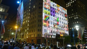 Images are projected on the Lindt Cafe building during a ceremony. (AAP)