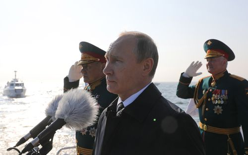 Russian President Vladimir Putin (C), Russian Defence Minister Sergei Shoigu (L) and Western Military District Commander Col. Gen Andrei Kartapolov (R) during the naval parade. (AAP)