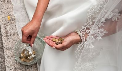 Bride holding coins