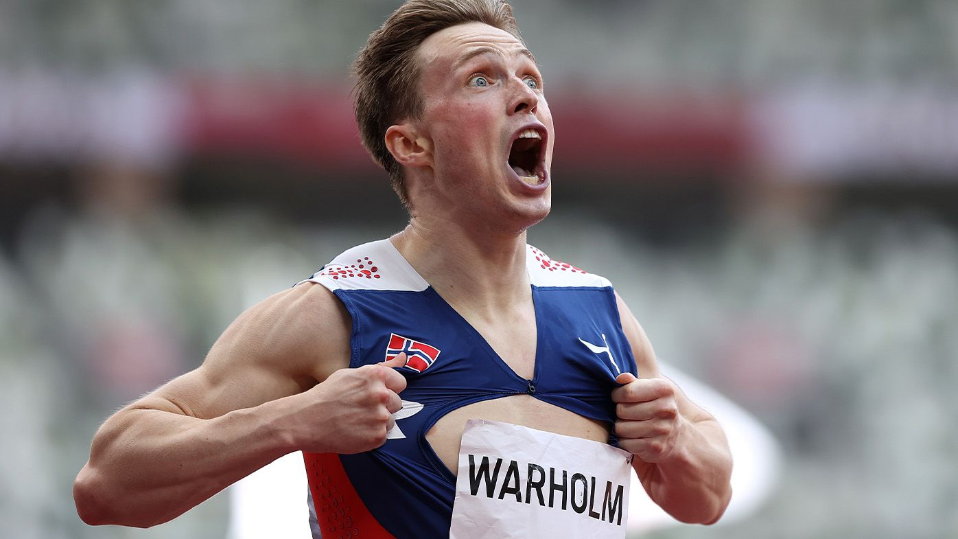 Norway's Karsten Warholm crushes world record in electric 400m Olympic hurdles final