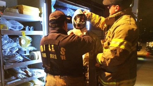 Dallas Fire Department workers suit up before entering the home of the second Texas nurse who tested positive for Ebola.