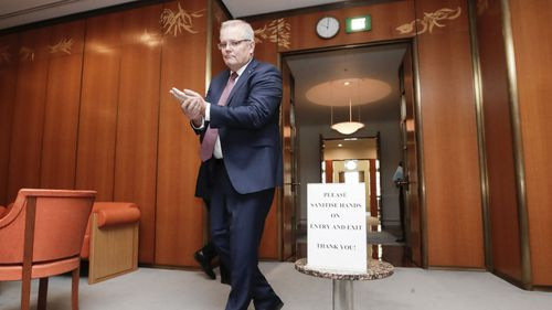 Scott Morrison sanitises his hands.