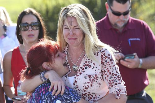 Parents wait near Stoneman Douglas High School. (AAP)