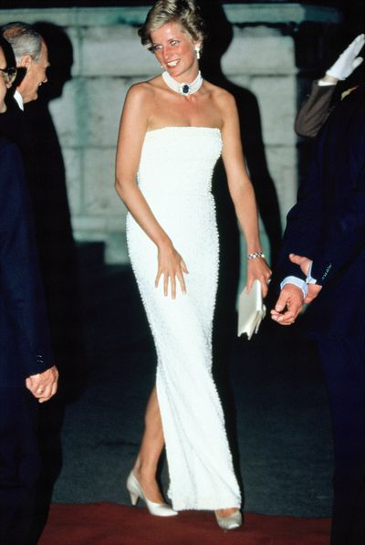 Elegant in a Catherine Walker strapless dress at a state banquet  during an official visit to Hungary in 1990.
