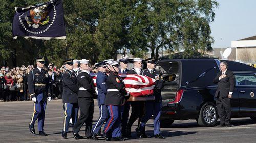 The procession also included a 21-gun salute in tribute of Mr Bush.