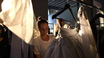 A stylist prepares dresses backstage ahead of the Maticevski show. (AAP)