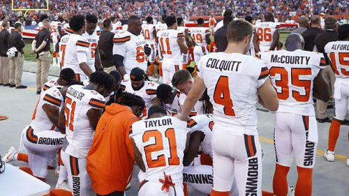 Cleveland Browns players kneel in protest during the national anthem.