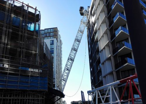Locals have launched a compensation claim against the crane's operator Probuild. (9NEWS)