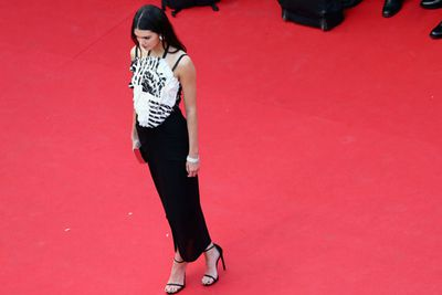 We're not sure why Kendall is even at Cannes, but she showed up looking very mature in a monochrome Chanel dress.