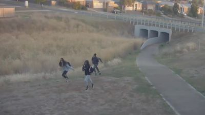 Girls flee after lighting fire under overpass