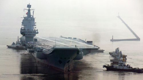China's first home-built aircraft carrier sets out from a port of Dalian DSIC, in 2018.