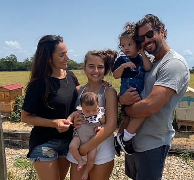 Wood with wife Snezana, stepdaughter Eve who is holding daughter Charlie, and Willow.