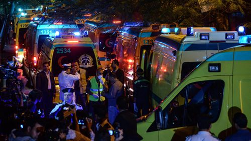 Ambulances carrying the bodies of the victims arrive in Cairo. (AAP)