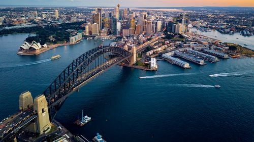Climbing the Sydney Harbour Bridge is a popular tourist activity.