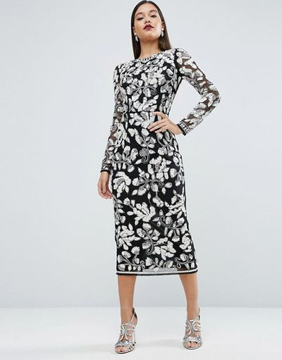 High drama on Derby Day. Keep head wear simple, such as a black bejewelled headband, with this ornate dress.