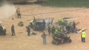 The car fell 10 metres off a cliff onto the sand of Maroubra Beach