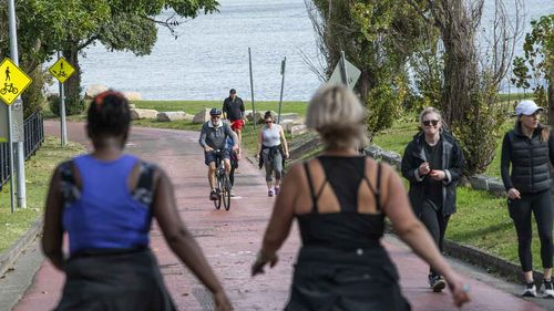 Walkers, runners and cyclists on the Bay Run in Rozelle, Sydney.