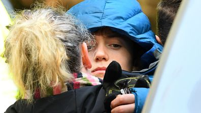 William Callaghan is hugged by his mum at the base camp at Mount Disappointment. He was found alive after two cold nights in Victoria's bush