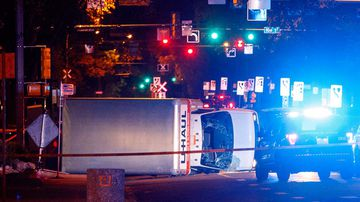 A U-Haul truck rests on its side after a high-speed chase with police in Edmonton Alta. (AP)