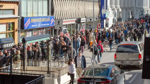 People line up for hours to buy marijuana after the substance was legalised in Canada.