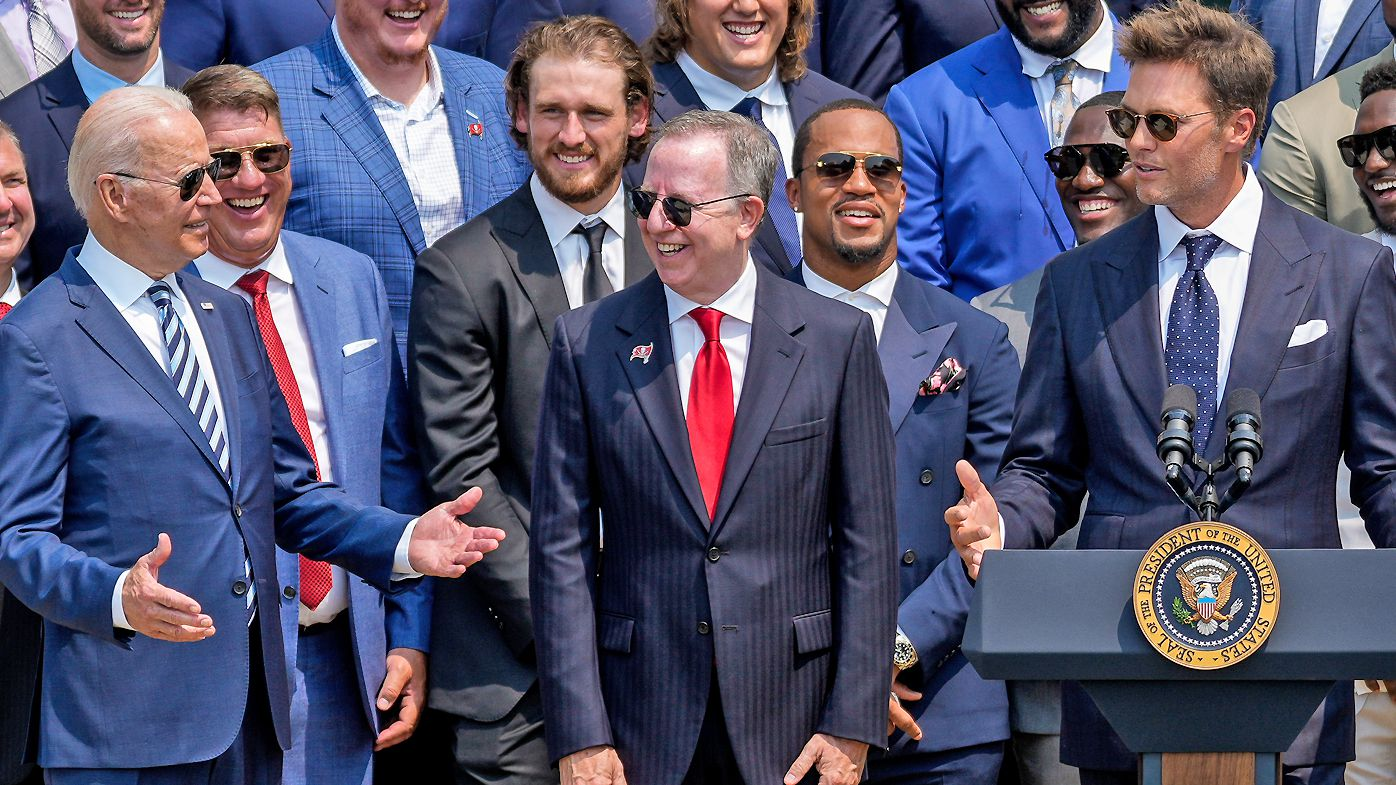 U.S. President Joe Biden laughs as quarterback Tom Brady jokes while speaking as the 2021 NFL Super Bowl champion Tampa Bay Buccaneers are welcomed to the South Lawn of the White House