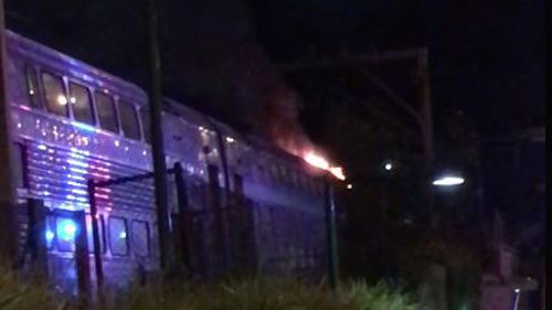 At least 60 passengers were evacuated after the train caught fire. (Timothy Wells/Facebook)