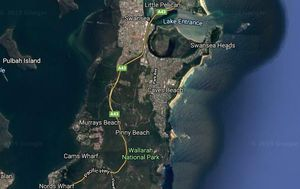 Dead body pulled from surf at Lake Macquarie beach
