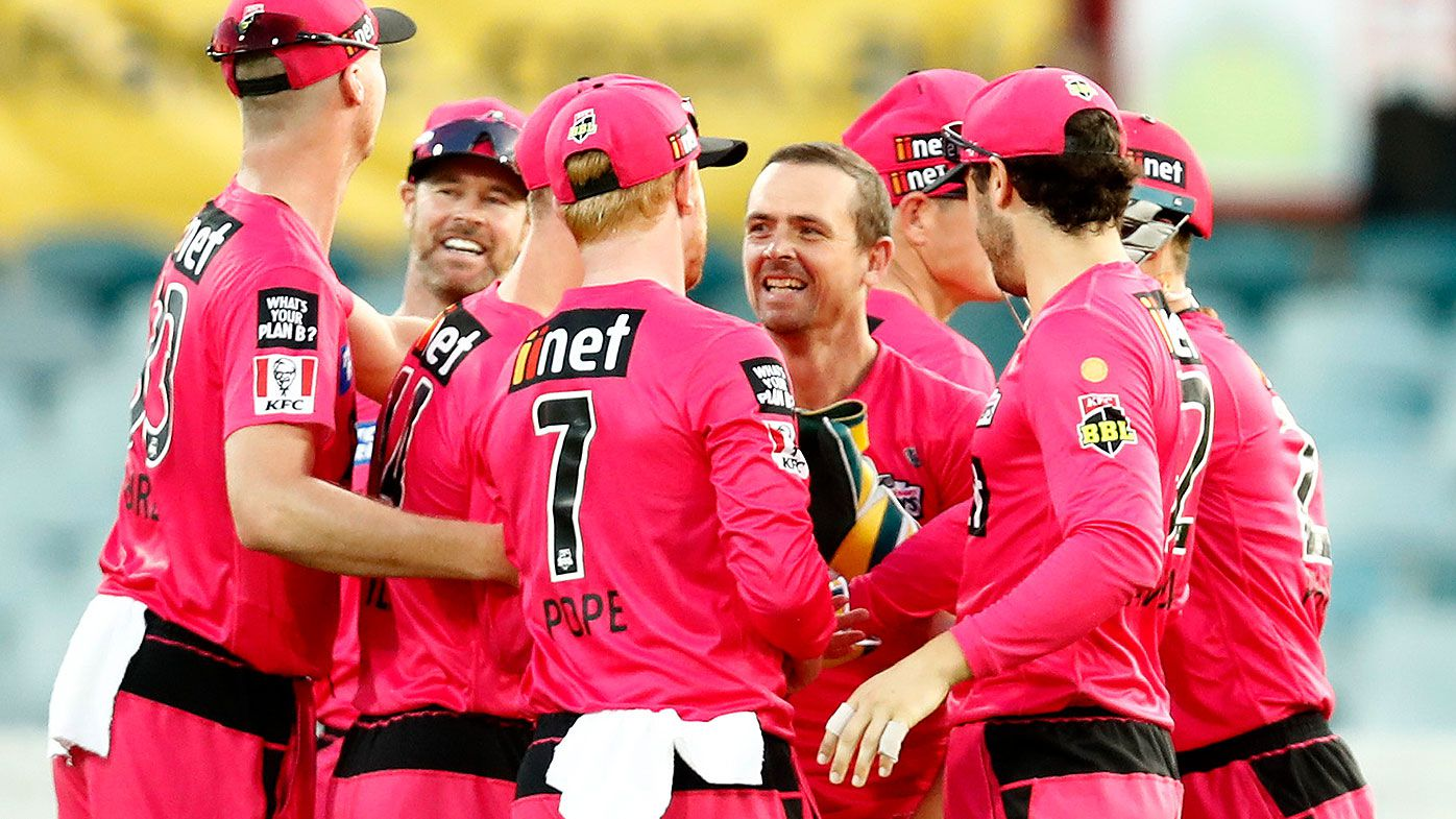 Stephen O'Keefe of the Sixers celebrates the wicket of Alex Hales of the Thunder during the Big Bash League match between the Sydney Thunder and the Sydney Sixers