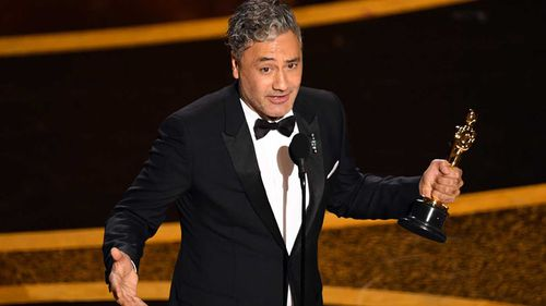 Taika Waititi accepts the Writing - Adapted Screenplay - award for 'Jojo Rabbit' onstage during the 92nd Annual Academy Awards.
