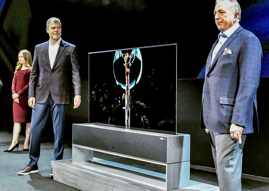 LG Electronics unveils its organic light-emitting diode television whose display can be rolled up like a piece of paper, shown at a the Consumer Electronics Show in Las Vegas.