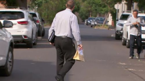 Detectives appeared to take evidence from the apartment after scouring the scene this morning. (9NEWS)