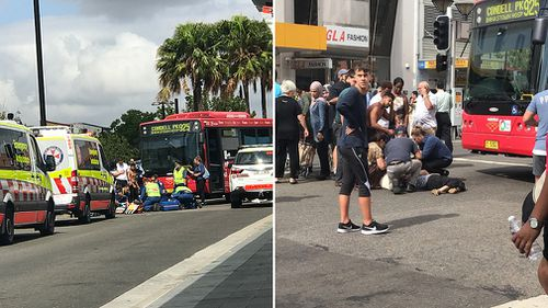 A woman, 81, was frantically helped by bystanders after being hit by a bus in Bankstown (Supplied).