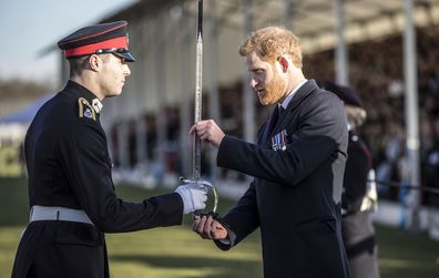 Britain's Prince Harry presents the sword of honour to the best overall officer cadet at The Royal Military Academy Sandhurst.