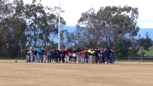 The Yarra Glen Football Club community gathered to pay tribute to Cooper Ratten. (9NEWS)