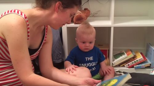 The parents have captured several moments where their baby sobs when a book has ended.