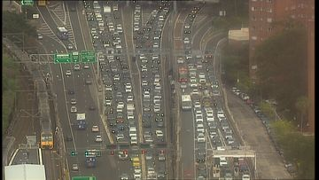An overheight truck has thrown peak-hour traffic into chaos, closing multiple lanes in the Sydney Harbour Tunnel.
