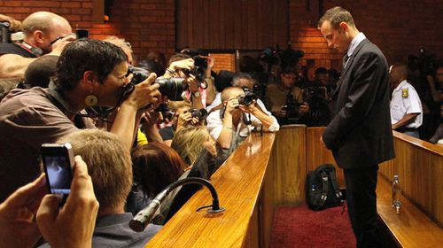 Oscar Pistorius faces a barrage of photographers on the fourth day of his bail hearing. (AAP)